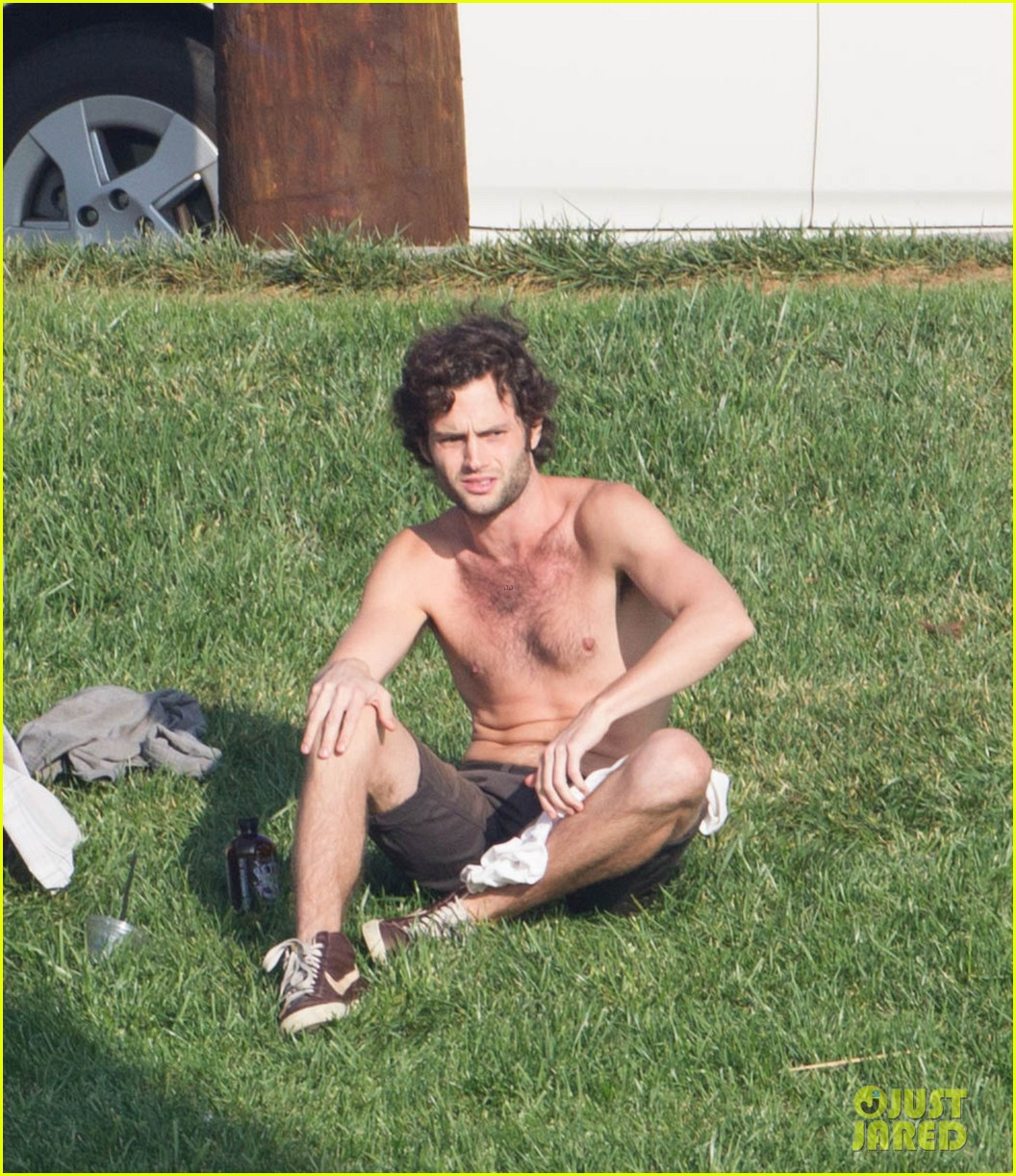 penn badgley goes shirtless in the park 02