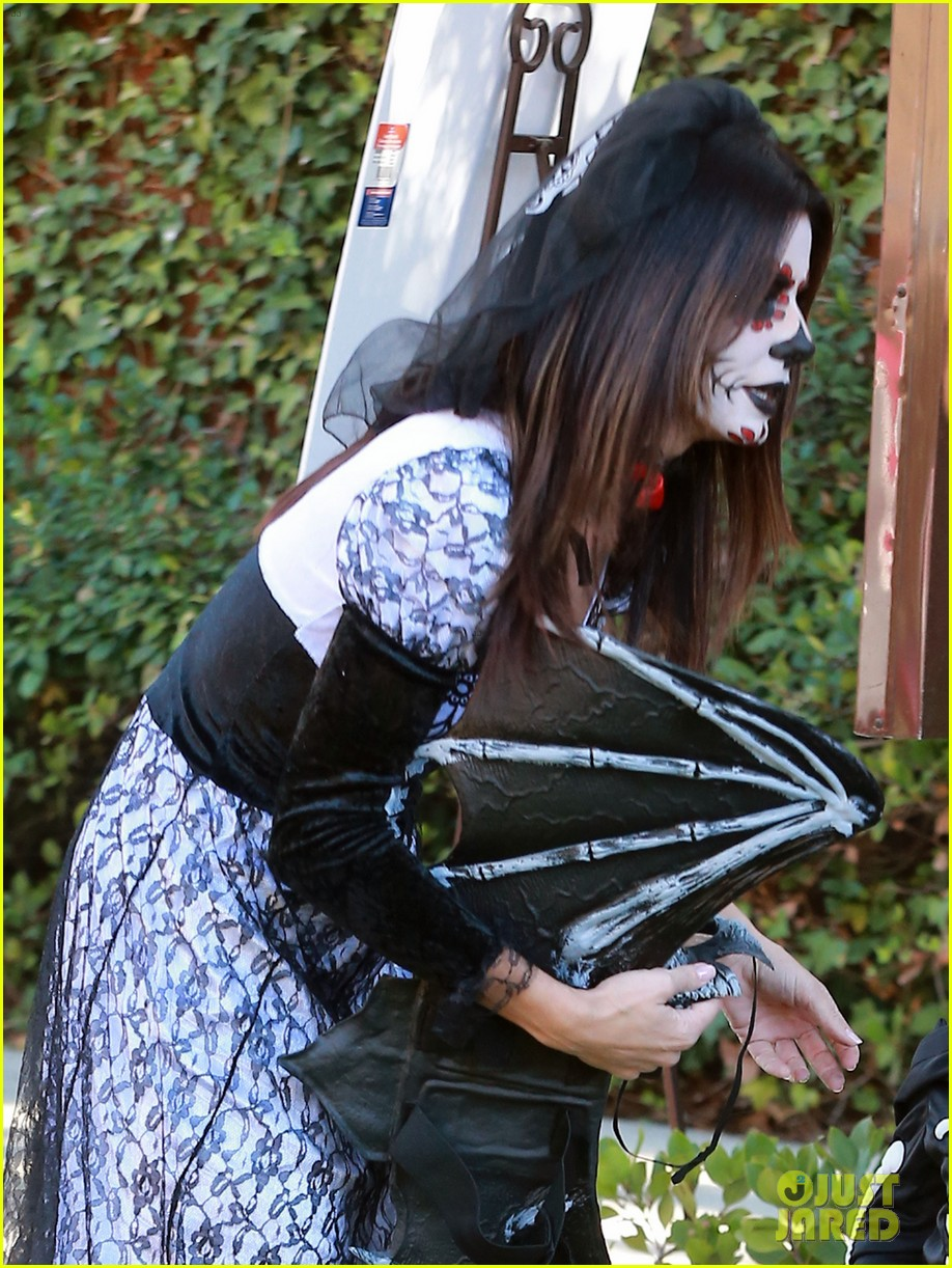 sandra bullock goes spooky for halloween party with louis 15