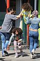 rose byrne quvenzhane wallis film separately on annie set 05
