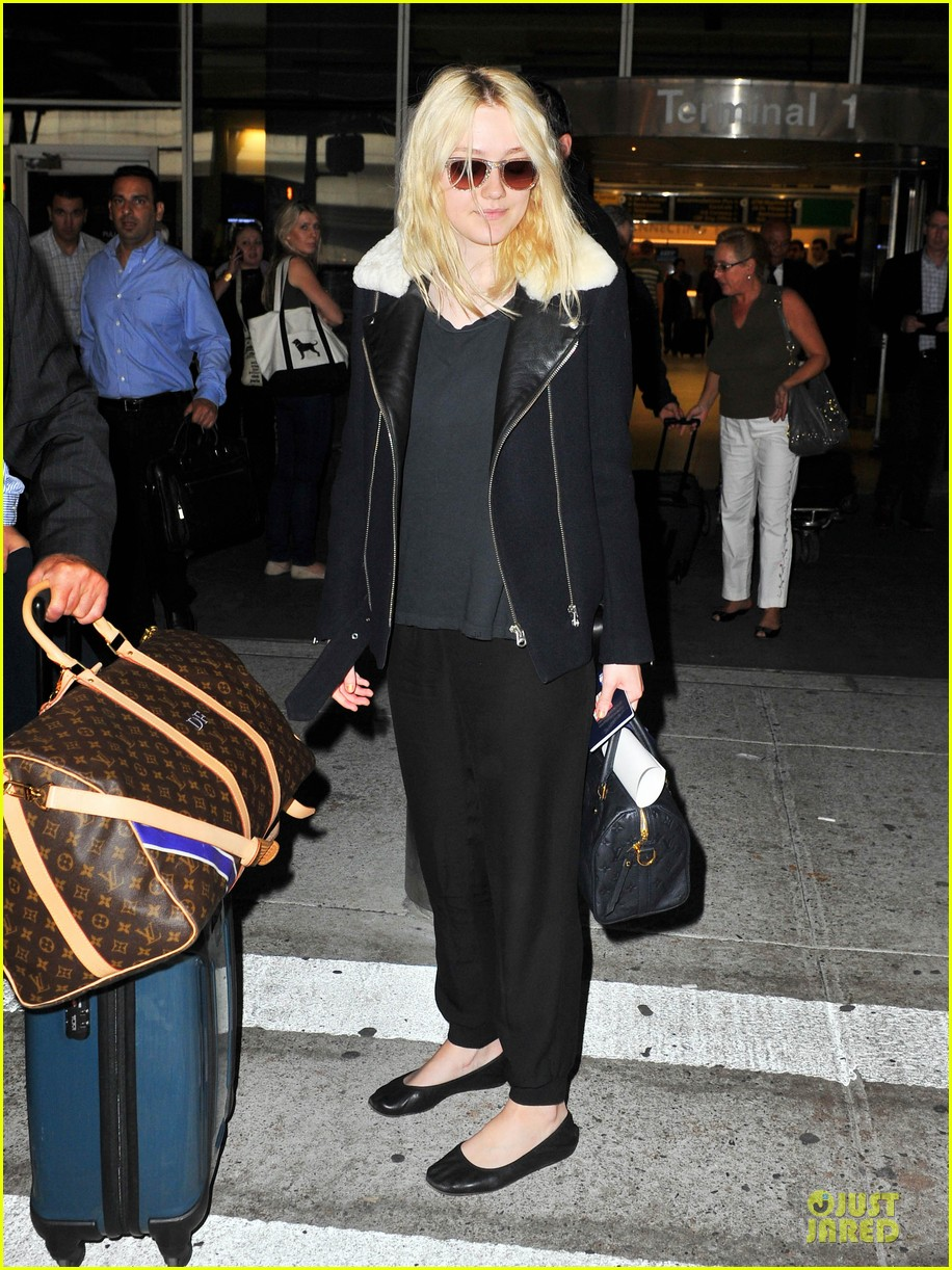 dakota fanning separate landings after paris fashion week 01
