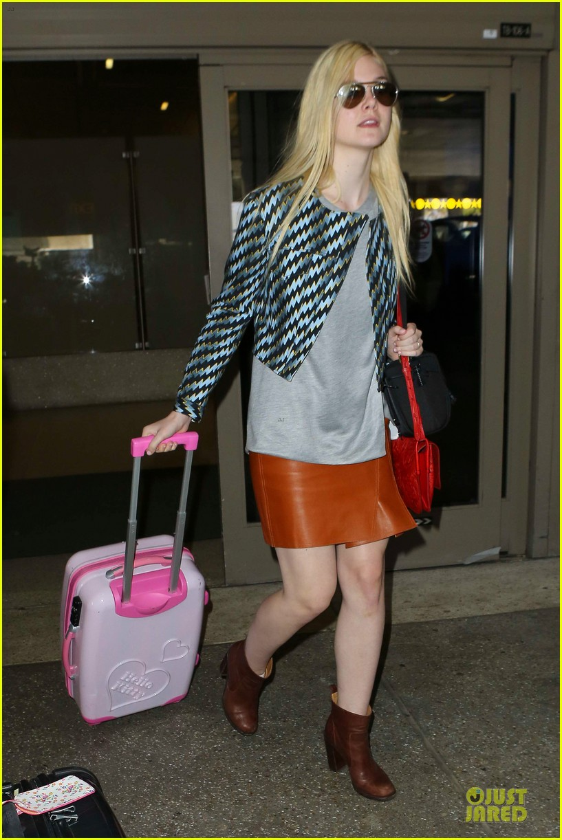 dakota fanning separate landings after paris fashion week 05