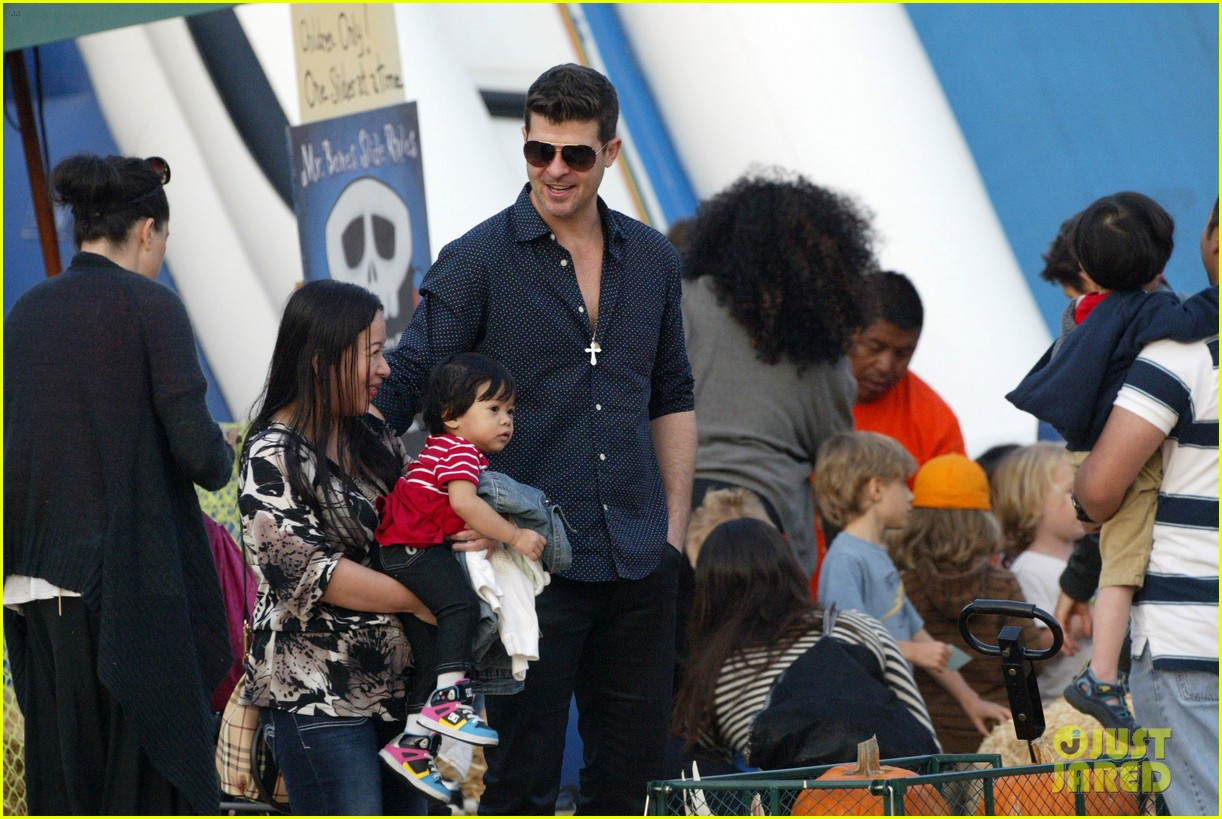 robin thicke paula patton smooches pumpkin patch 342981013