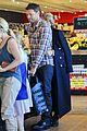 sam worthington lara bingle hold hands at grocery store 03