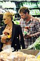 sam worthington lara bingle hold hands at grocery store 04