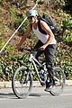 josh duhamel bares his biceps in muscle tank on bike ride 24