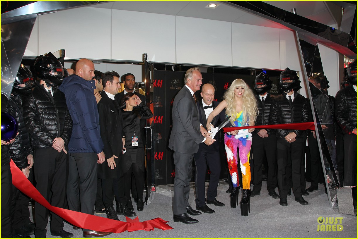 lady gaga cuts red ribbon at hm store opening 072992401