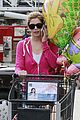 ashley greene leaves store with balloons party supplies 04