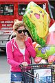 ashley greene leaves store with balloons party supplies 08