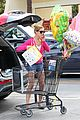 ashley greene leaves store with balloons party supplies 13