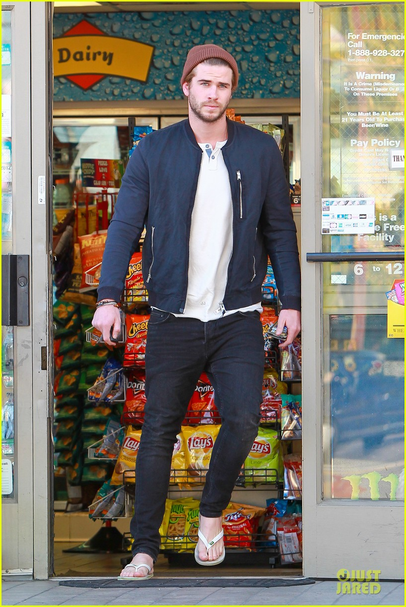 liam hemsworth steps out after catching fire breaks box office record 03