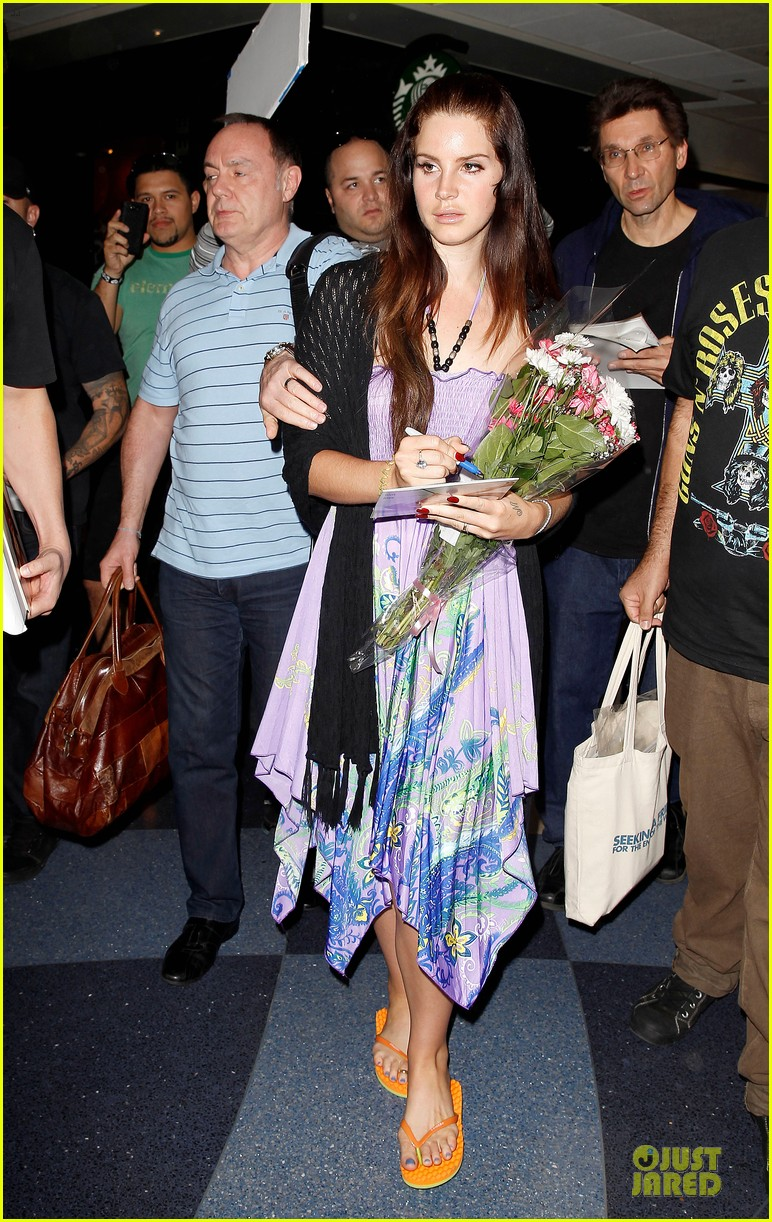 lana del rey receives flowers at lax airport 01