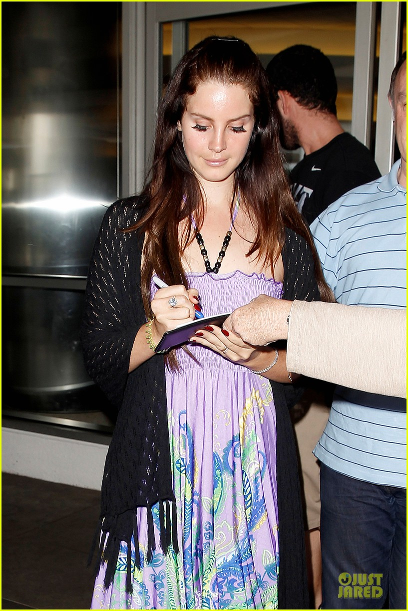lana del rey receives flowers at lax airport 02