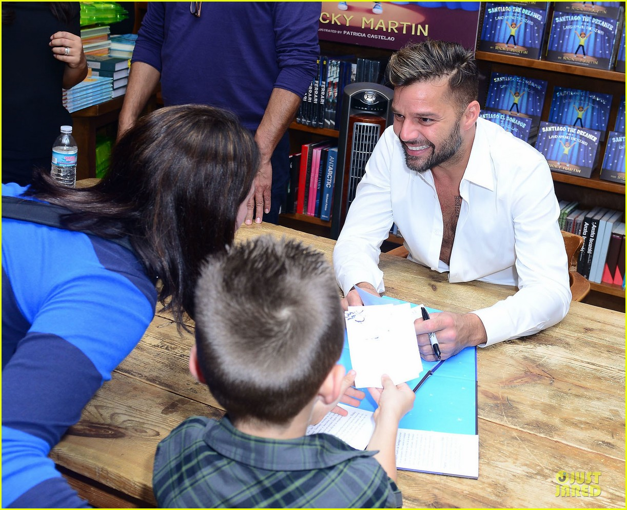 ricky martin flashes chest hair for santiago signing 092994121