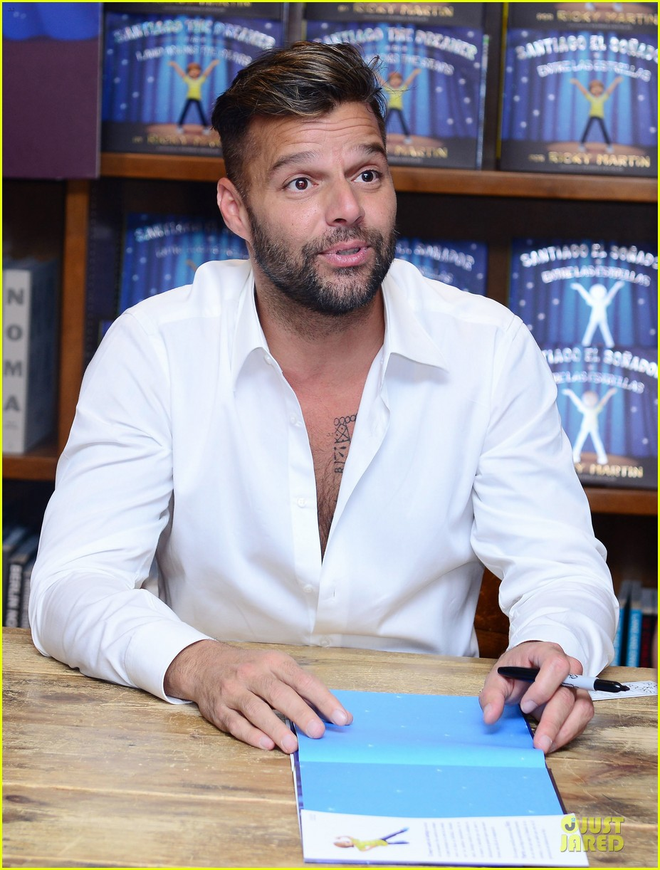 ricky martin flashes chest hair for santiago signing 12