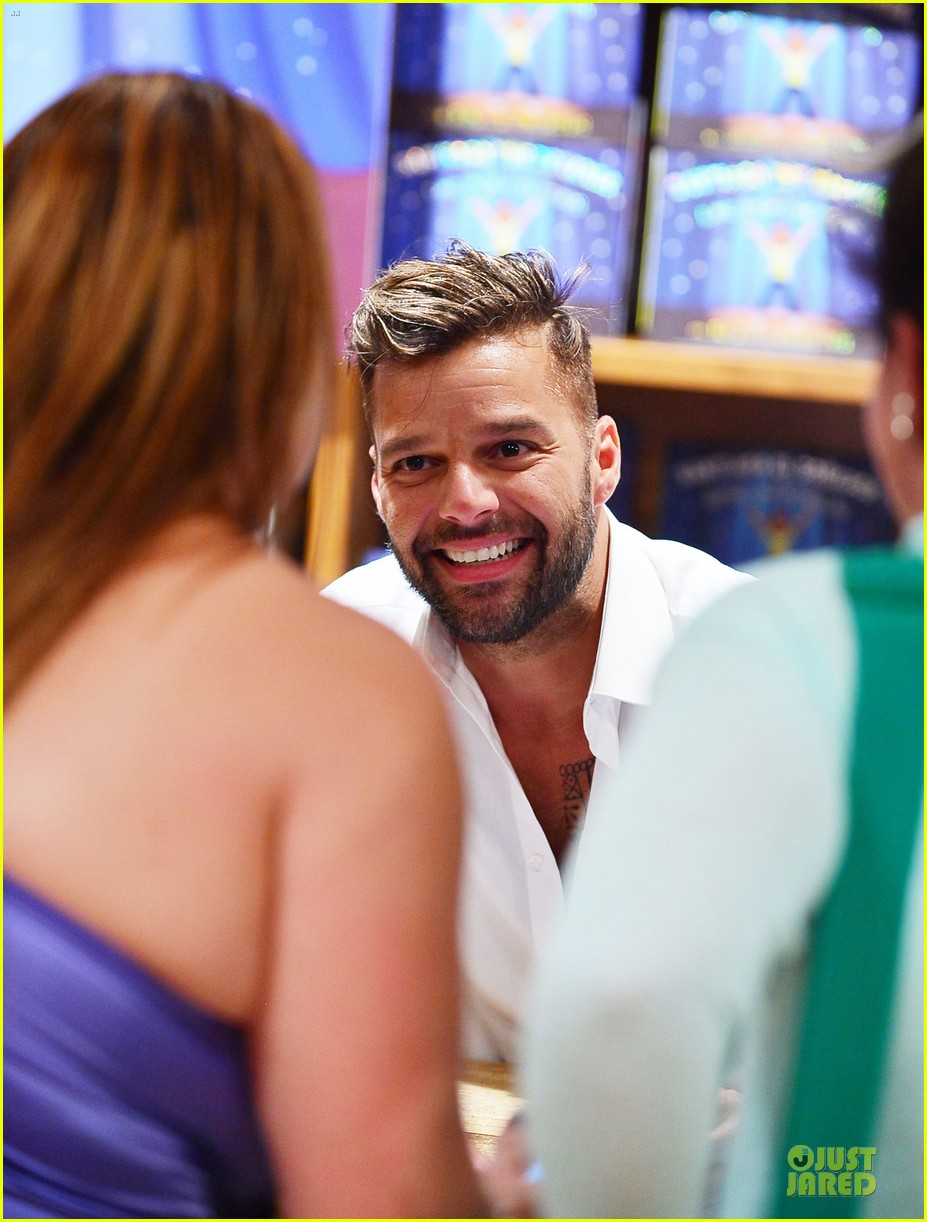 ricky martin flashes chest hair for santiago signing 19