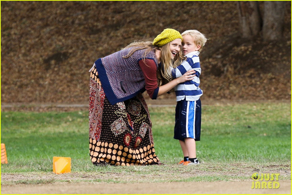 teresa palmer dives for ball during family football game 13