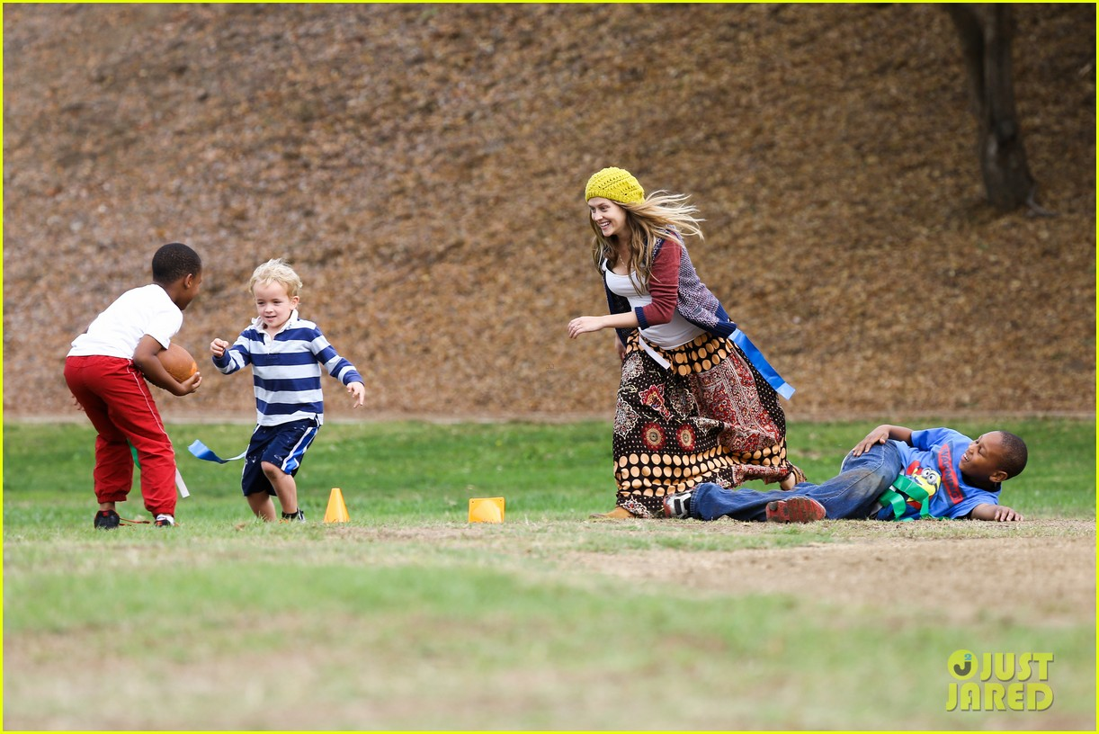 teresa palmer dives for ball during family football game 20