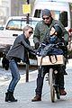 naomi watts straps in boys for bike ride with liev schreiber 03