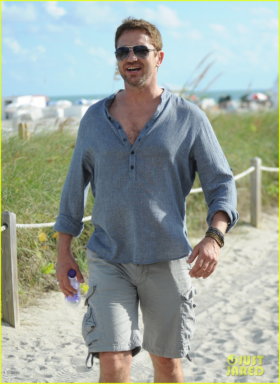 gerard butler enjoys beach time during art basel 02