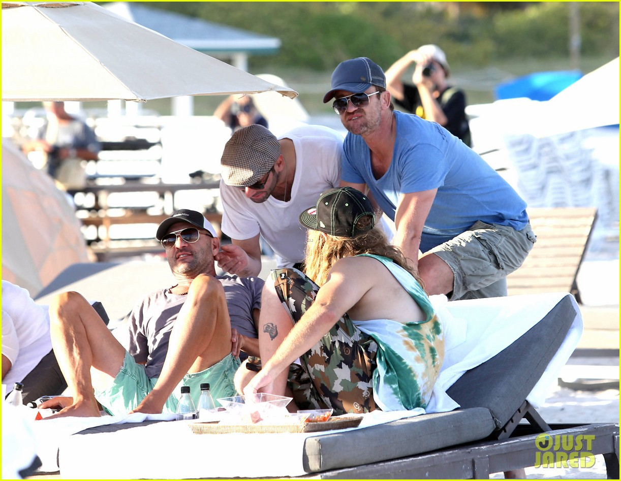 gerard butler kicks back takes photos during golf cart ride 14
