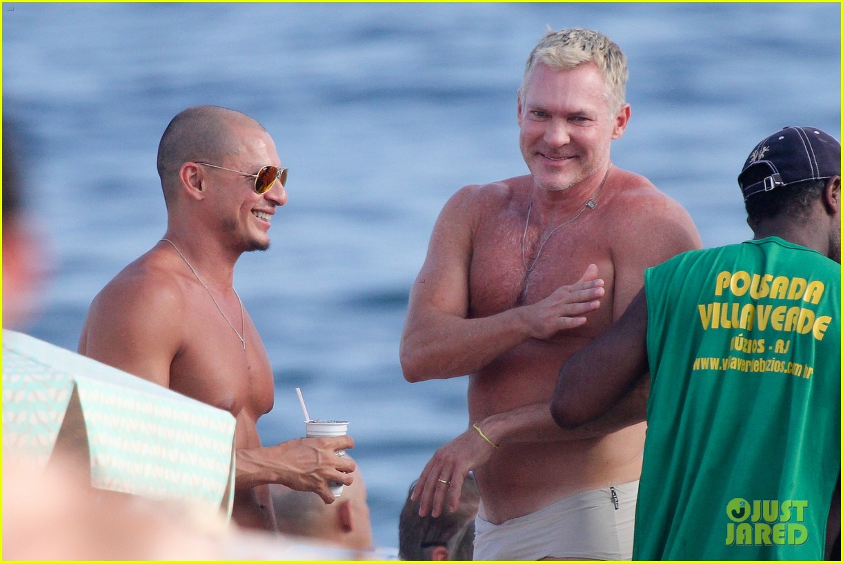 sam champion strips off board shorts to show speedo 213020040