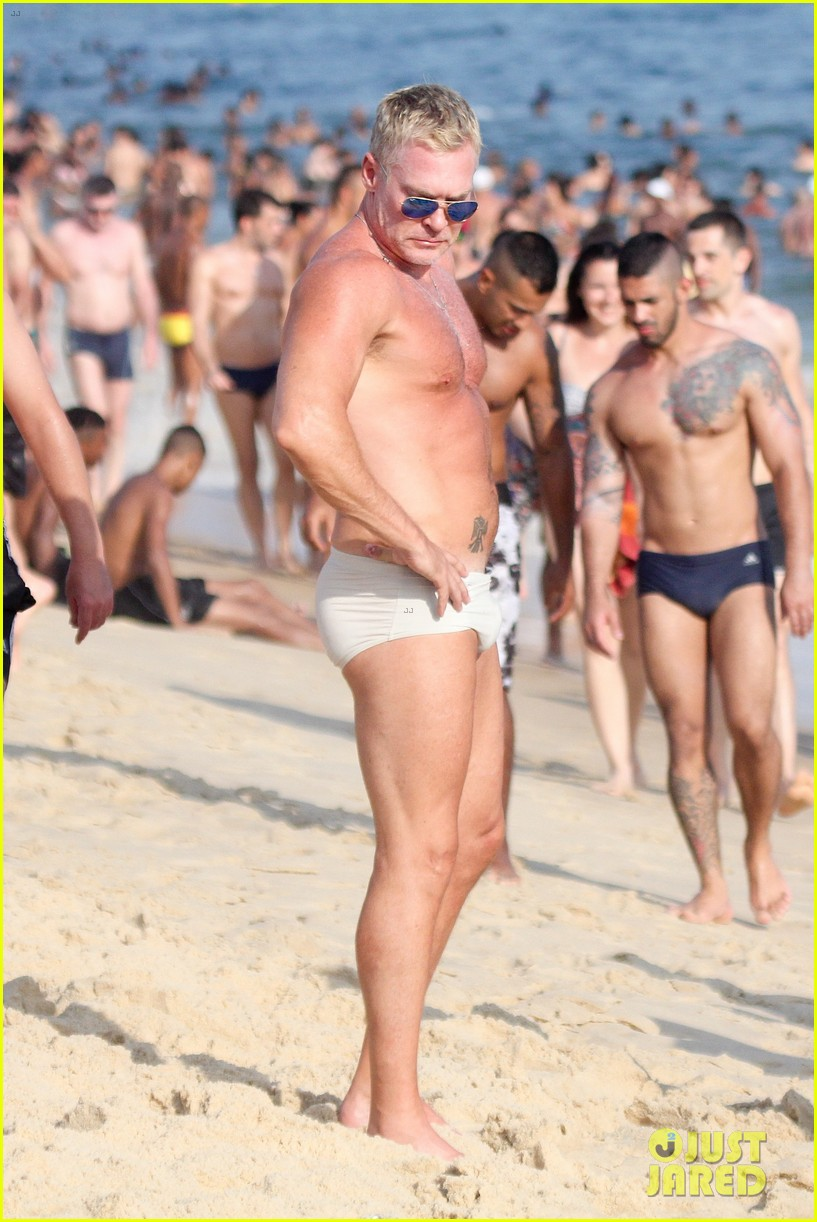 sam champion strips off board shorts to show speedo 273020046