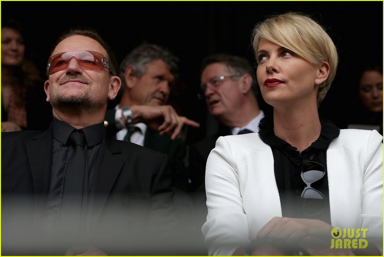 charlize theron pays respects at nelson mandela funeral 063008997
