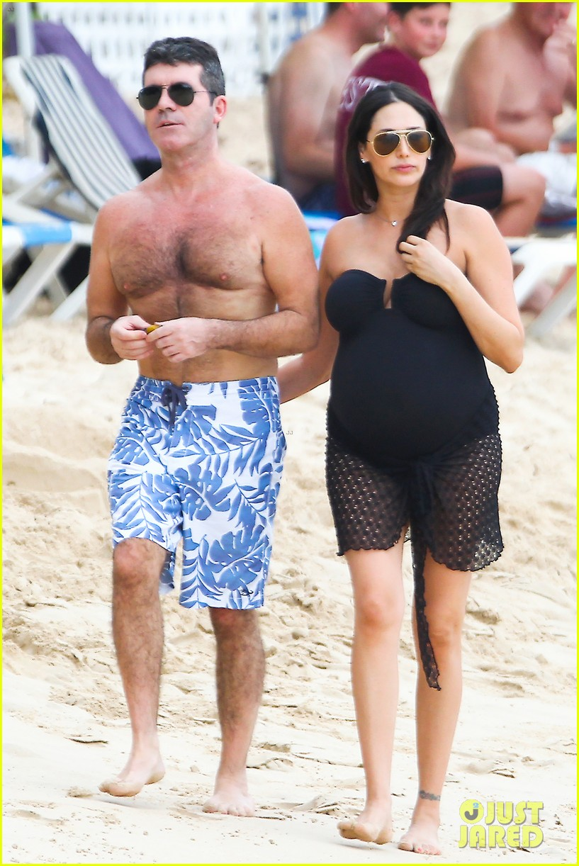 simon cowell shirtless beach stroll with pregnant girlfriend lauren silverman 093017995