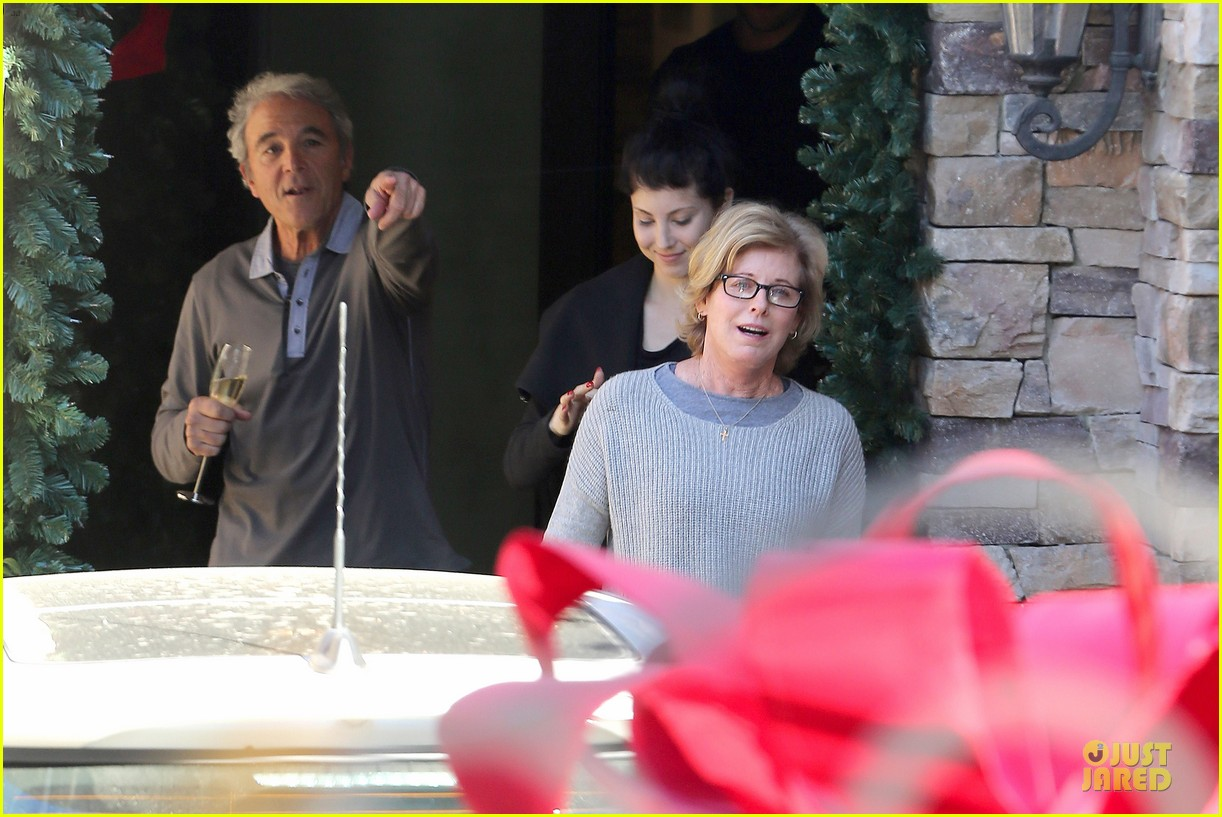 kaley cuoco surprises parents with lexus christmas gift 04