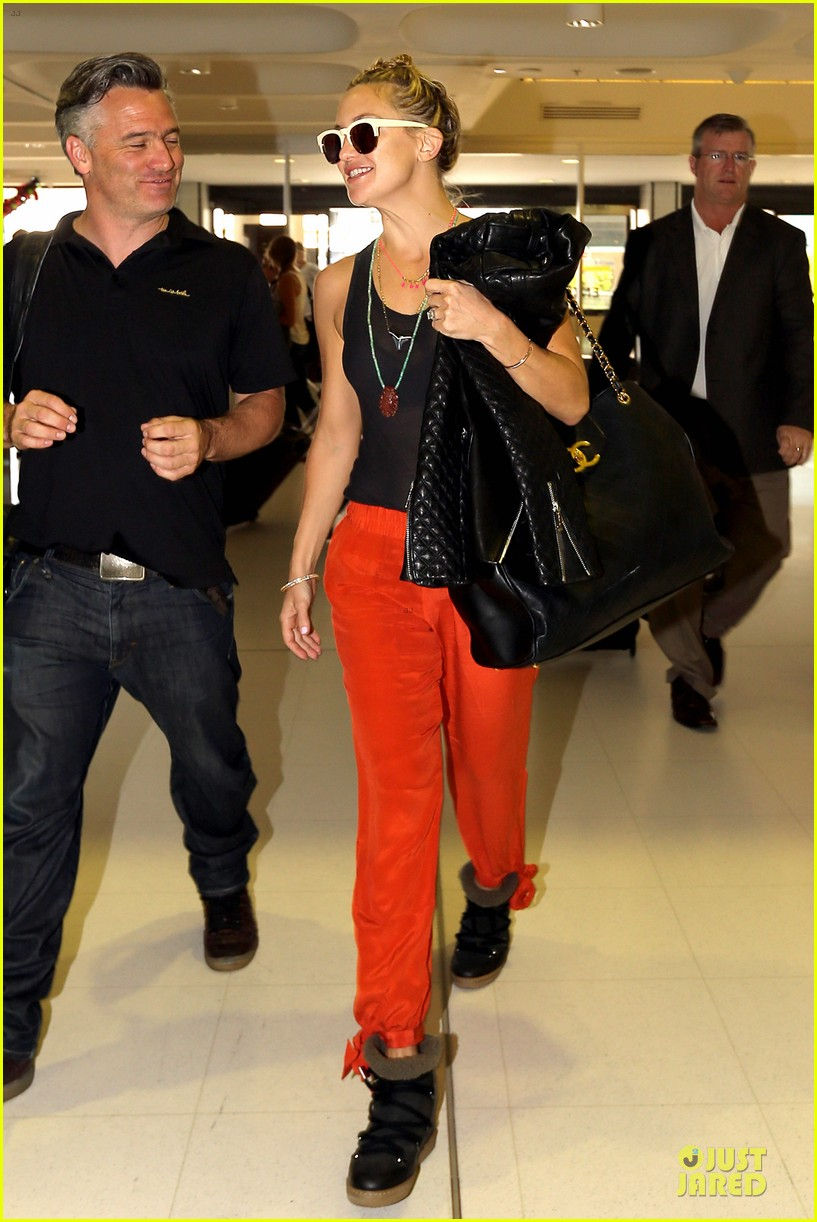 kate hudson bright orange sydney departure 10