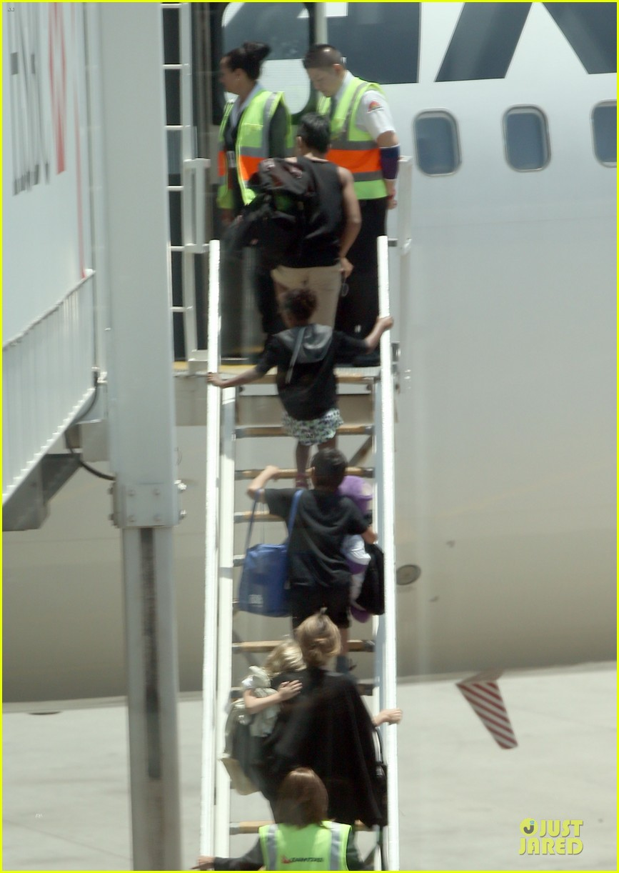 angelina jolie sydney holiday departure with the kids 01