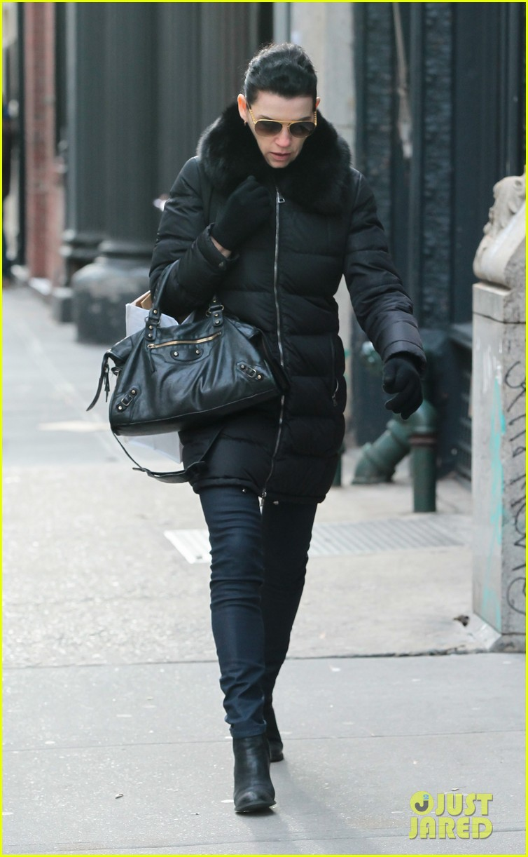 julianna margulies braves brisk weather for christmas eve walk 04