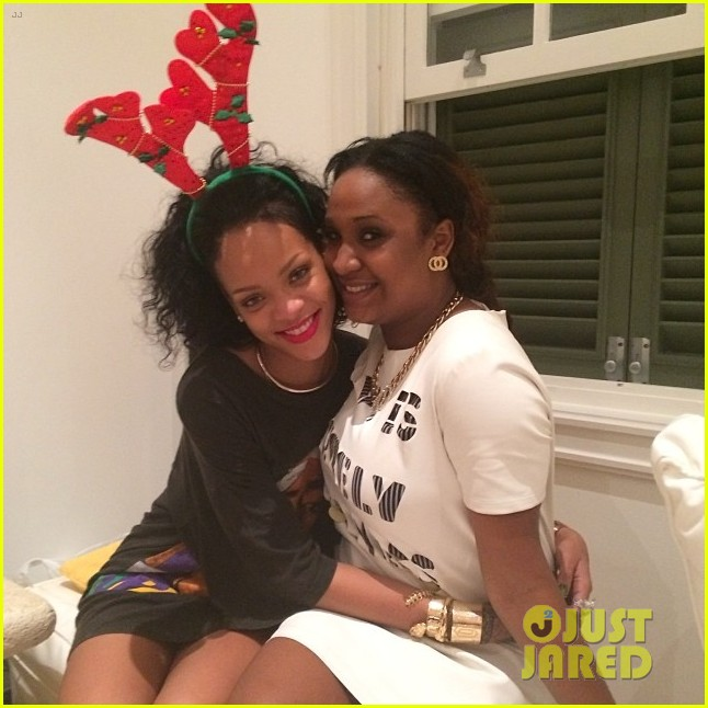 rihanna is a red nosed reindeer at her christmas eve party 02