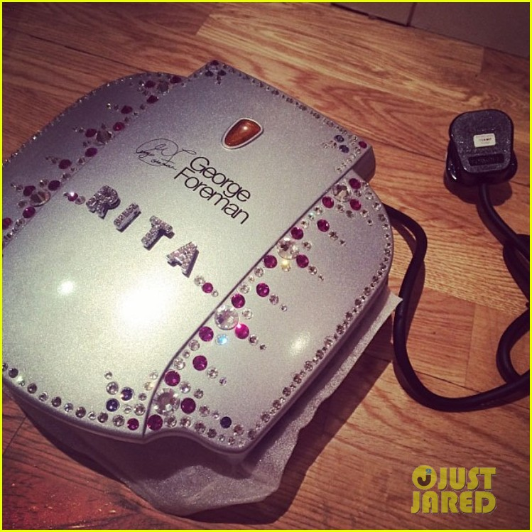 rita ora receives personalized george foreman grill 03