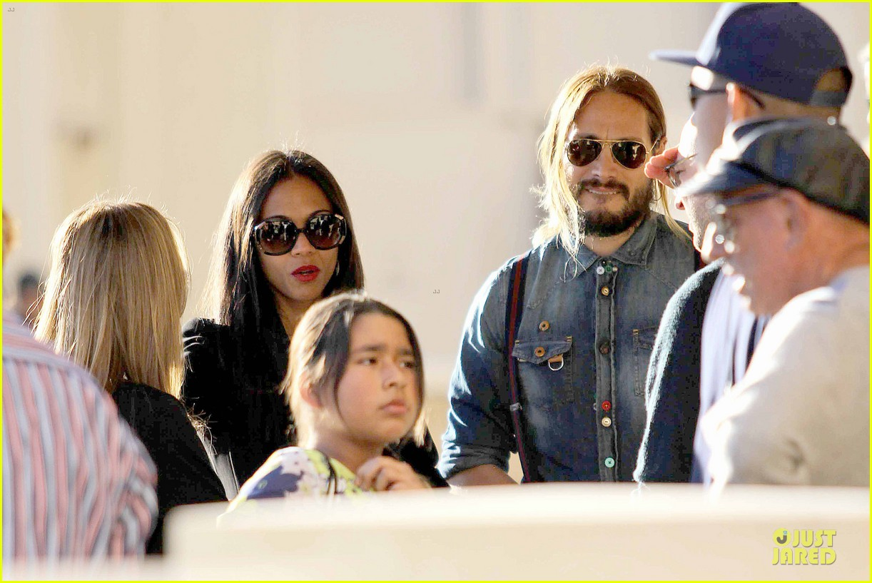 zoe saldana adoring kiss from marco perego at barneys 07