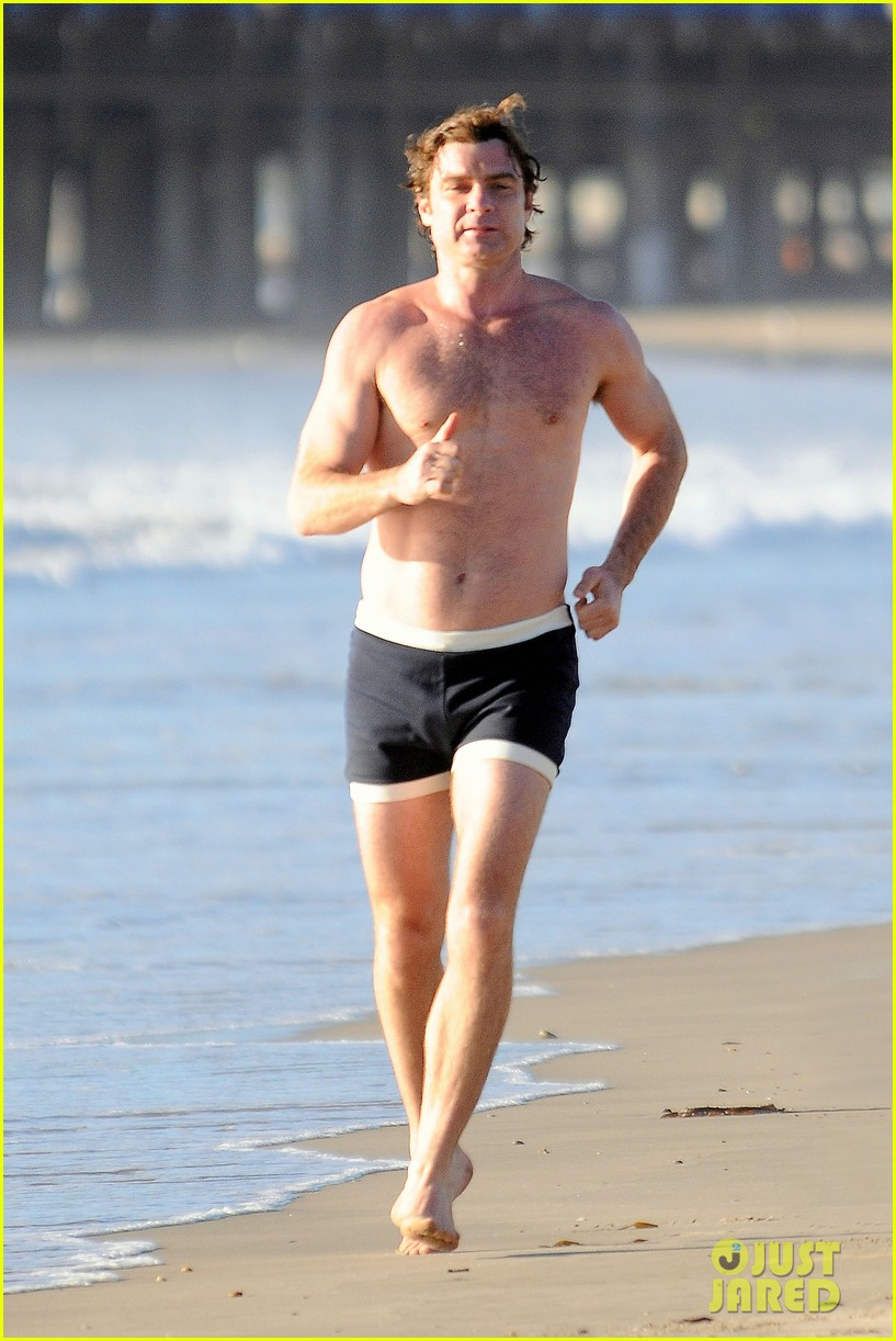 liev schreiber goes shirtless in skimpy swimsuit at the beach 04