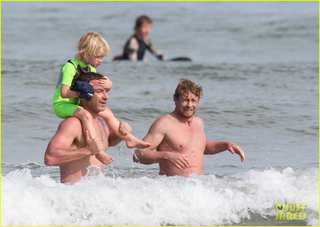 naomi watts sunbathes liev schreiber swims shirtless 04