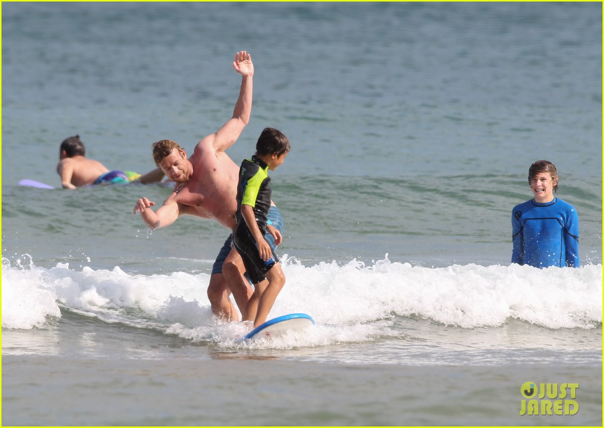 naomi watts sunbathes liev schreiber swims shirtless 133015402