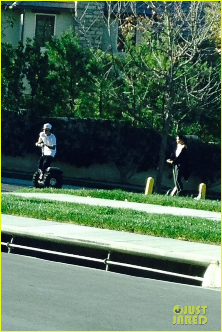justin bieber selena gomez ride segways together photo 01