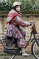 helena bonham carter bikes in the rain with son billy 04