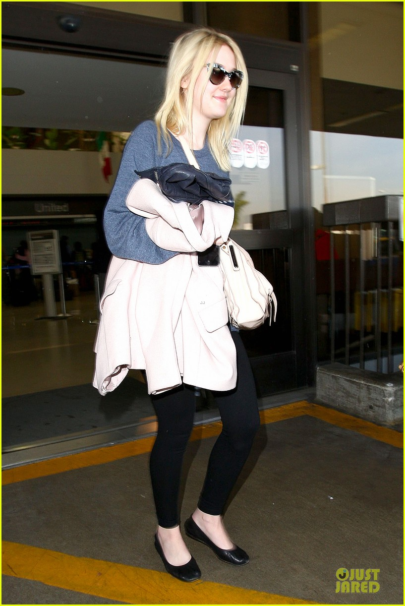 dakota fanning ends january with casual lax airport landing 103043018
