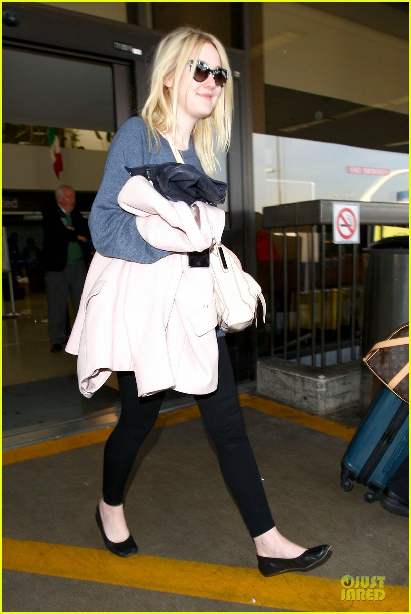 dakota fanning ends january with casual lax airport landing 11