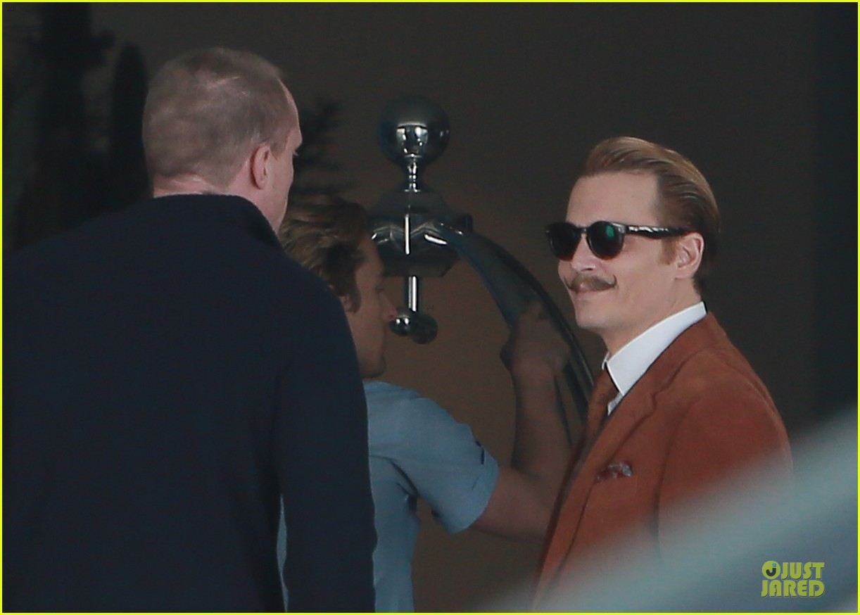 johnny depp mortdecai set with bikini clad babes 193024211