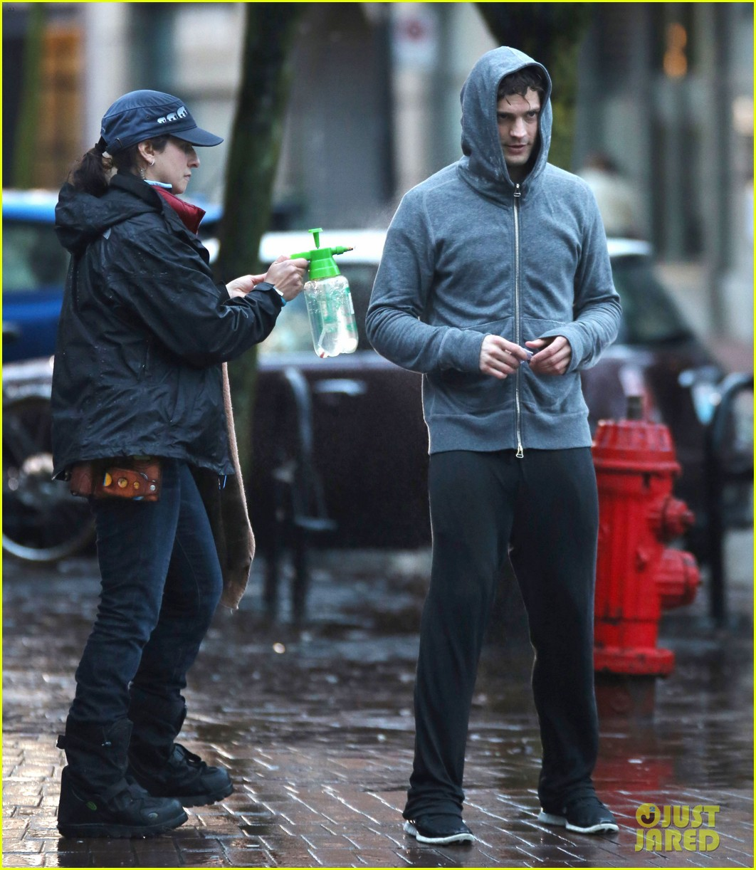 jamie dornan runs in the rain for fifty shades of grey 26