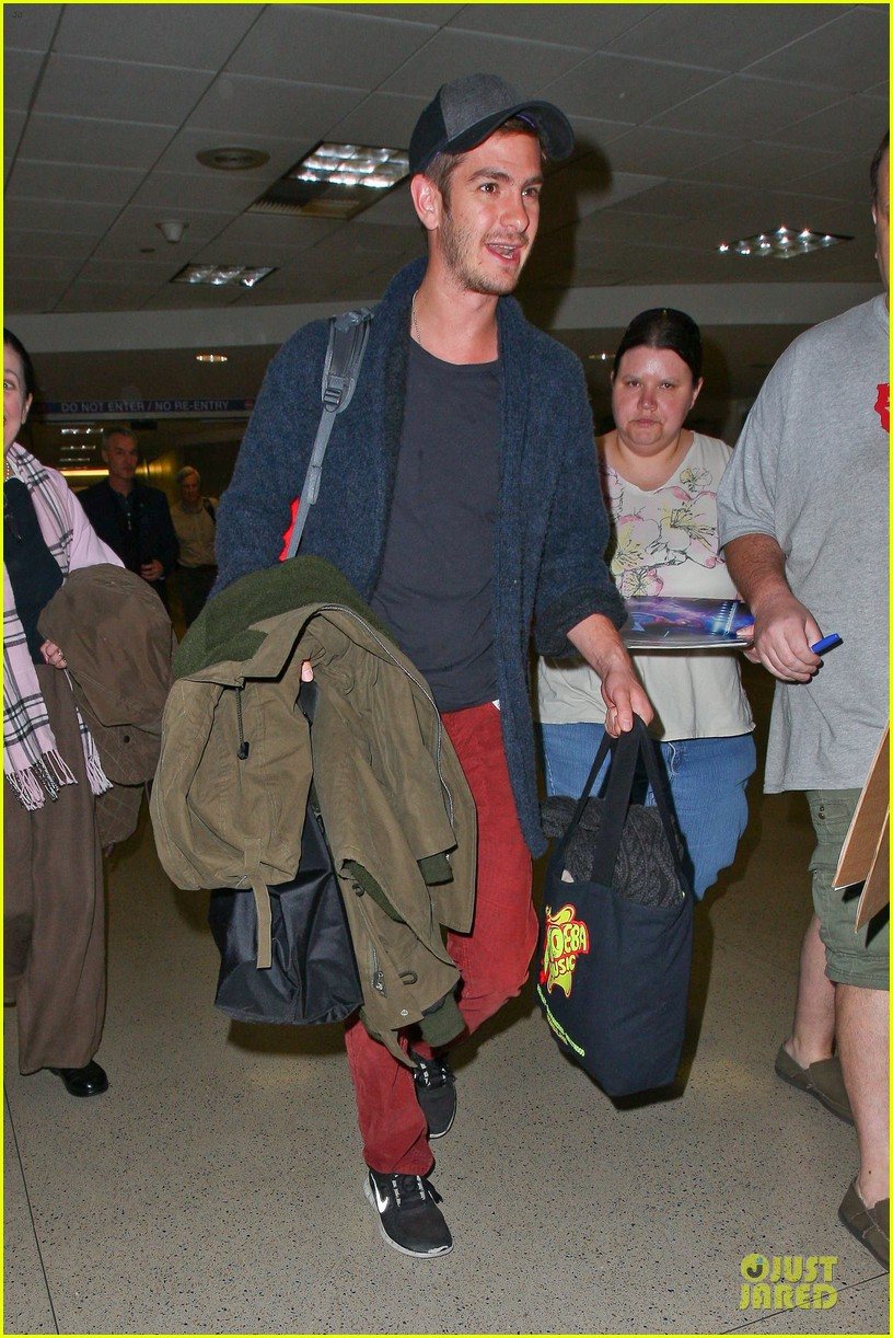 andrew garfield poses with spiderman fan at lax airport 133042317