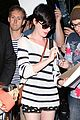 anne hathaway greets mob of fans at lax 26