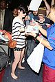 anne hathaway greets mob of fans at lax 31