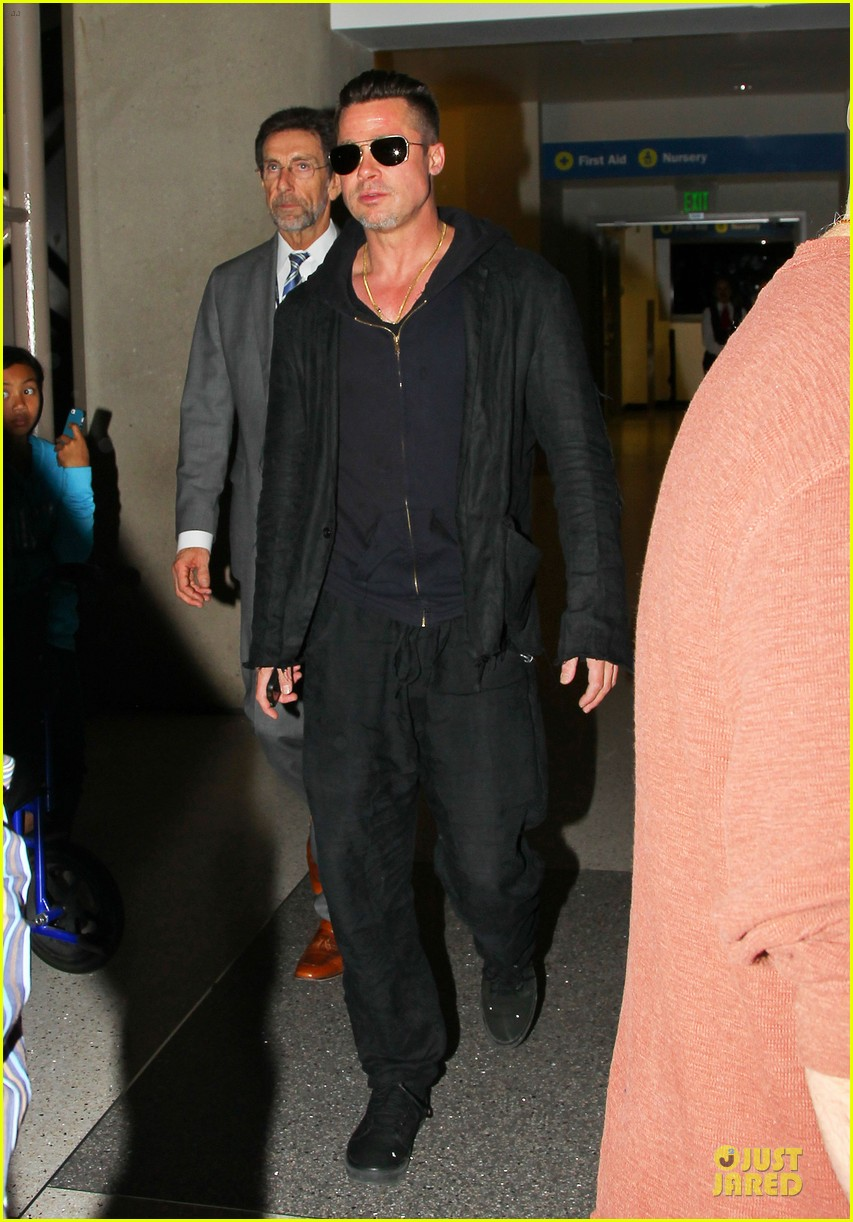 brad pitt lax arrival after angelina jolie difret news 01