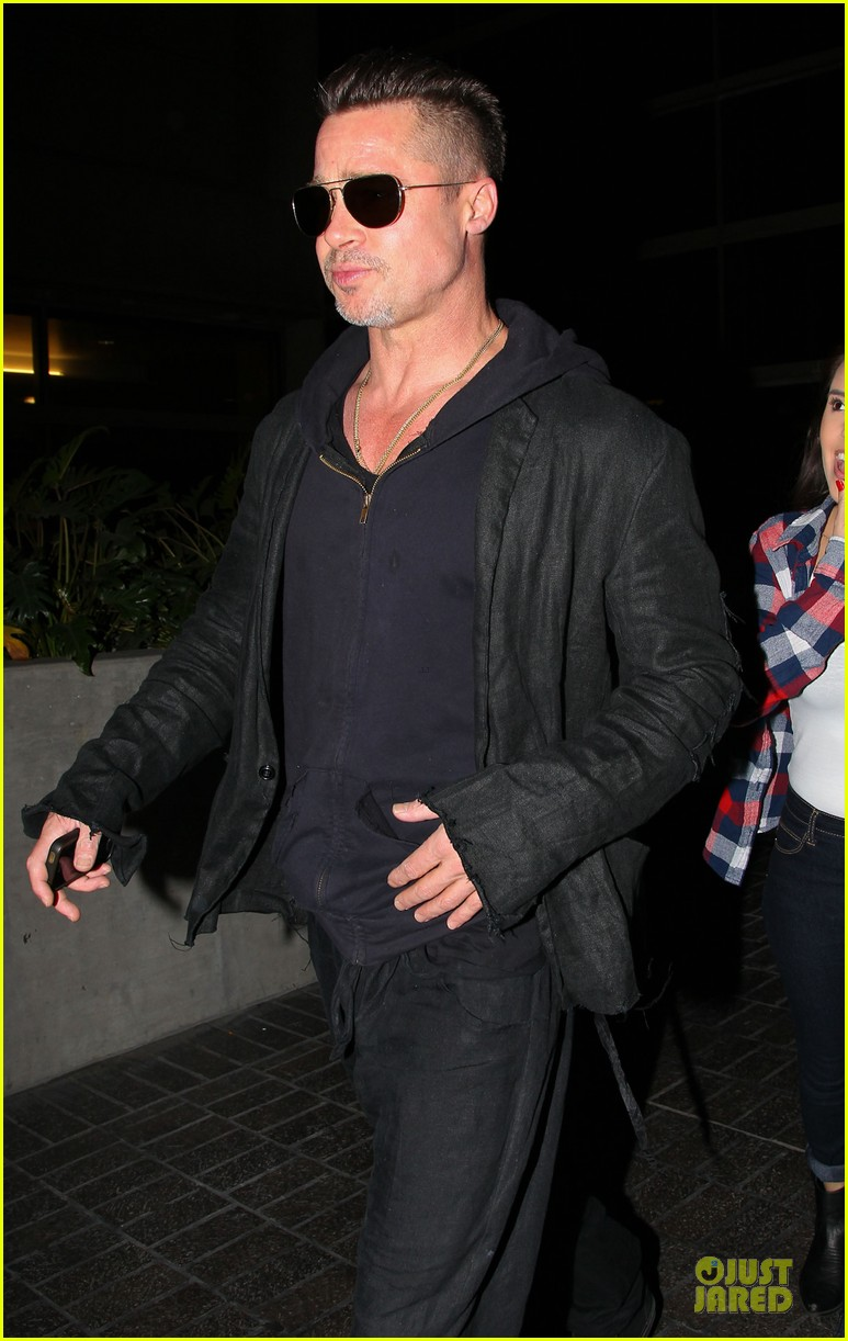 brad pitt lax arrival after angelina jolie difret news 04
