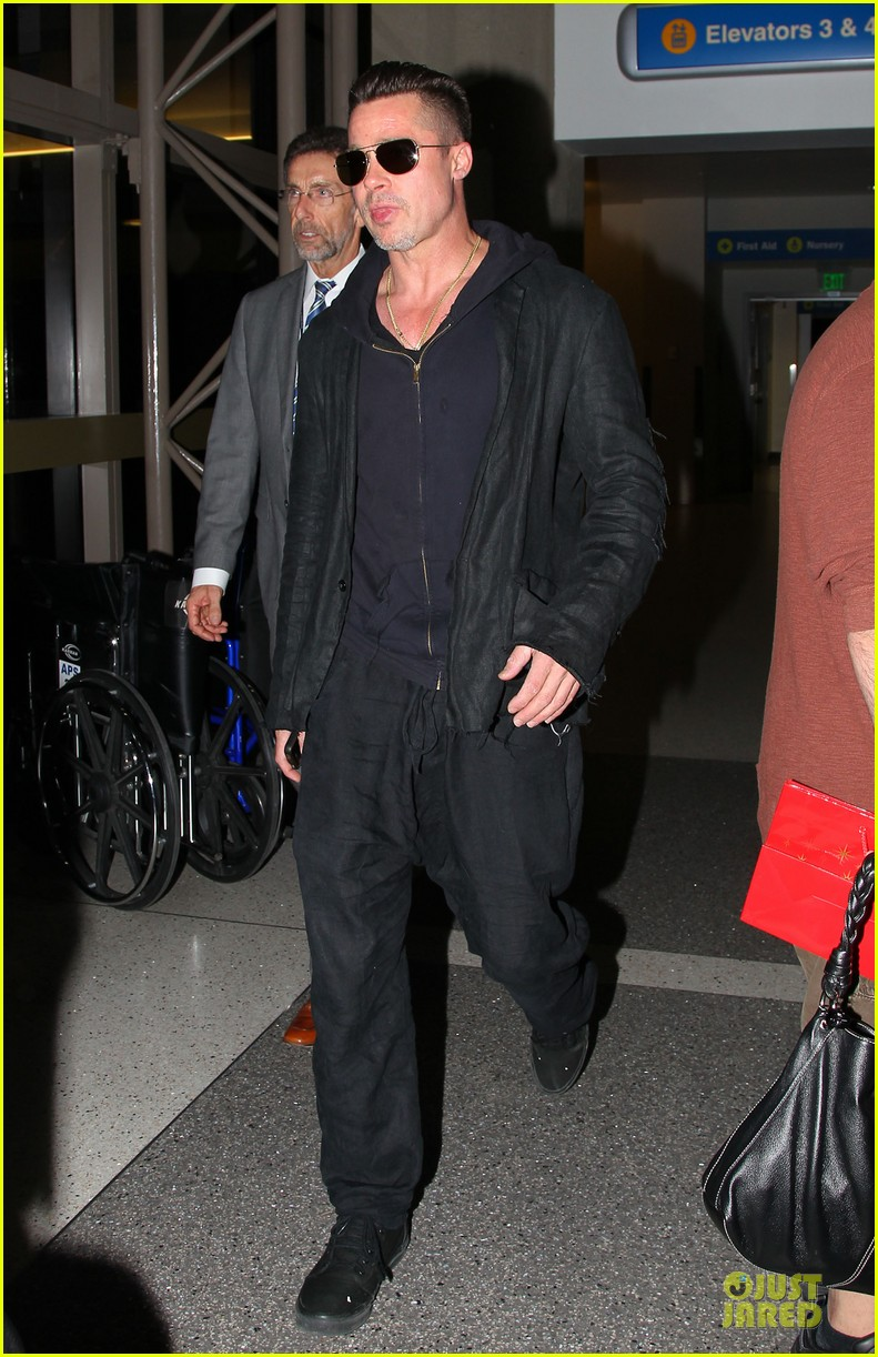 brad pitt lax arrival after angelina jolie difret news 06
